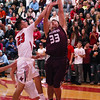 STAN HUDY - SHUDY@DIGITALFIRSTMEDIA.COM<br /> Stillwater sophomore Brian McNeil gets a contested shot off against Mechanicville's Luciano D'Ambro under the basket Tuesday night in Wasaren League action.