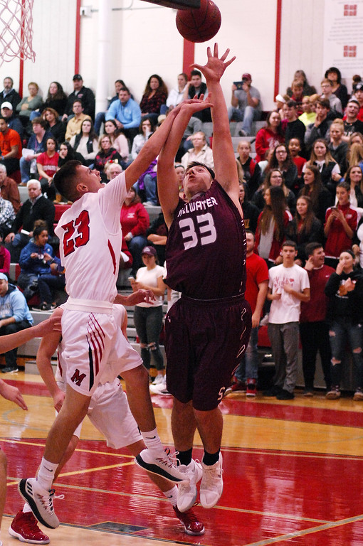 . STAN HUDY - SHUDY@DIGITALFIRSTMEDIA.COMStillwater sophomore Brian McNeil gets a contested shot off against Mechanicville\'s Luciano D\'Ambro under the basket Tuesday night in Wasaren League action.