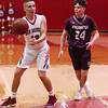 STAN HUDY - SHUDY@DIGITALFIRSTMEDIA.COM<br /> Mechanicville  junior Peter Enzien looks to pass the ball down low in front of Stillwater's Cooper Monast Tuesday night in Wasaren League action.