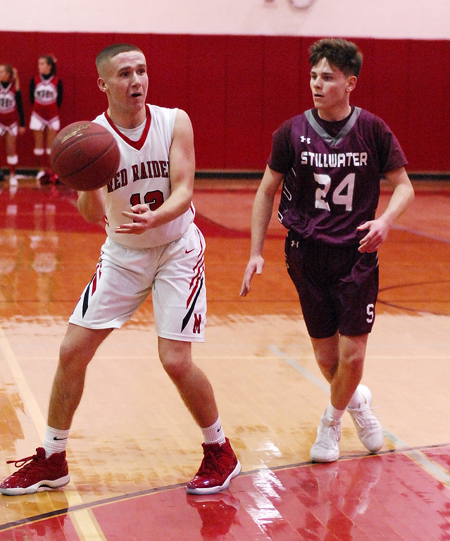 . STAN HUDY - SHUDY@DIGITALFIRSTMEDIA.COMMechanicville  junior Peter Enzien looks to pass the ball down low in front of Stillwater\'s Cooper Monast Tuesday night in Wasaren League action.
