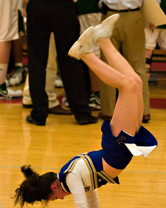 What fun would a basketball game be without a tumbling cheerleader?