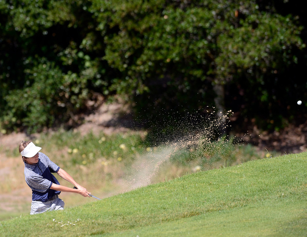 . Aptos\' Adam McDonald hits his ball from a trap on the ninth green during the CCS Boys Golf Championships at Laguna Seca Golf Ranch in Monterey on Tuesday May 9, 2017. (David Royal - Monterey Herald)
