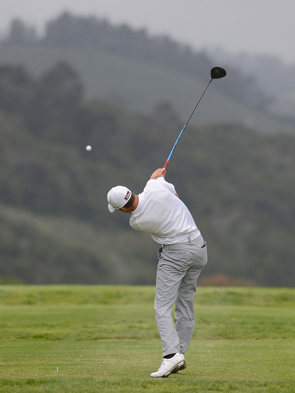 . Carmel\'s George McNeely tees off on the third hole during the CCS Boys Golf Championship second regional at Laguna Seca Golf Ranch in Monterey on Wednesday May 10, 2017. (David Royal - Monterey Herald)
