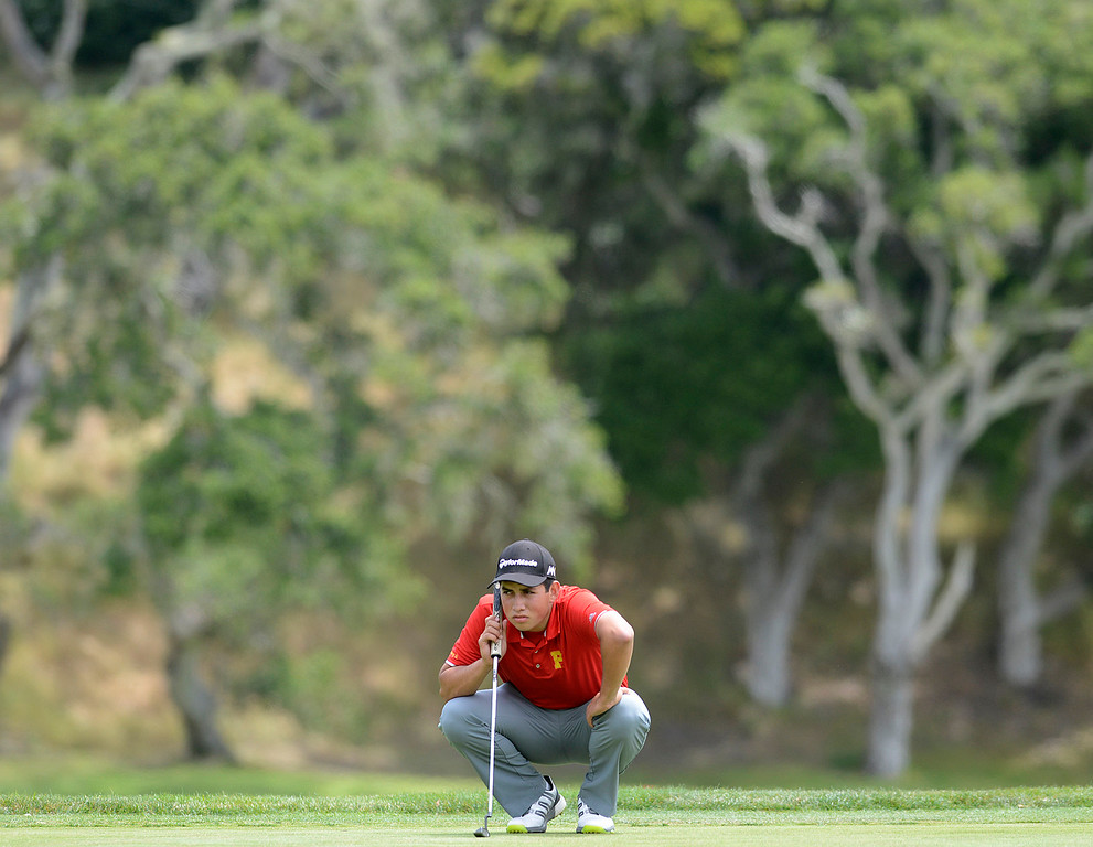 . Palma\'s Michael Carrillo lines up his putt before making a birdie on the 17th green during the CCS Boys Golf Championship second regional at Laguna Seca Golf Ranch in Monterey on Wednesday May 10, 2017. (David Royal - Monterey Herald)