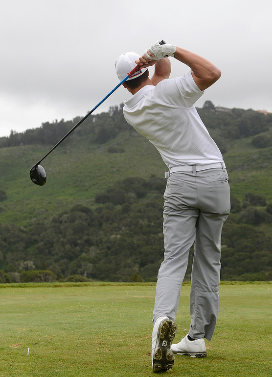 . Carmel\'s George McNeely tees off on the first hole during the CCS Boys Golf Championship second regional at Laguna Seca Golf Ranch in Monterey on Wednesday May 10, 2017. (David Royal - Monterey Herald)