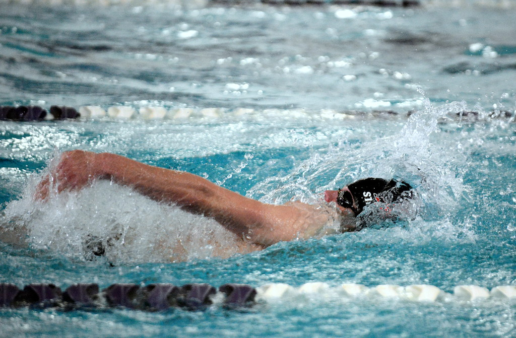 . Loveland\'s Gavin Quinlan works his way to a victory in the 100-yard backstroke at the boys City Meet on Tuesday at the Mountain View Aquatic Center. (Mike Brohard/Loveland Reporter-Herald)