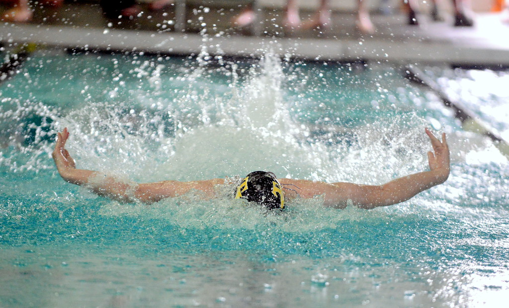 . Thompson Valley\'s Ben Smith gets full extention on his way to winning the 100-yard butterfly, his second victory of the day at the boys City Meet on Tuesday at the Mountain View Aquatic Center. (Mike Brohard/Loveland Reporter-Herald)