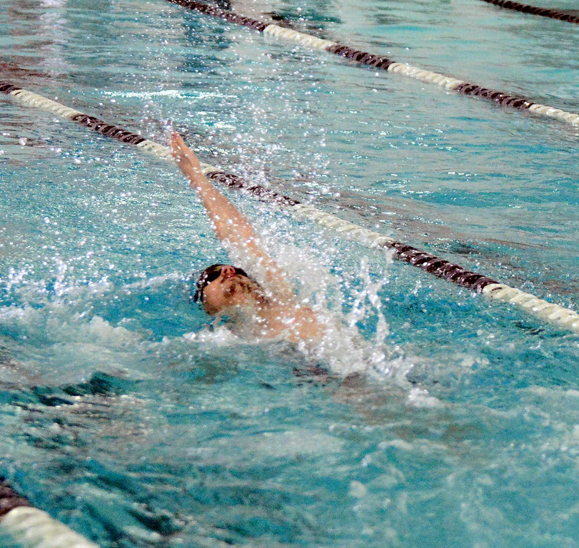 . Mountain View\'s Noah Floyd swims the backstroke leg of the 200-yard invidual medley at the boys City Meet on Tuesday at the Mountain View Aquatic Center. (Mike Brohard/Loveland Reporter-Herald)