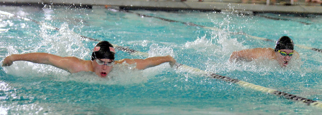 . Loveland\'s Connor Lindgren (left) and Mountain View\'s Julian Goering compete in the 100-yard butterfly at the boys City Meet on Tuesday at the Mountain View Aquatic Center. (Mike Brohard/Loveland Reporter-Herald)