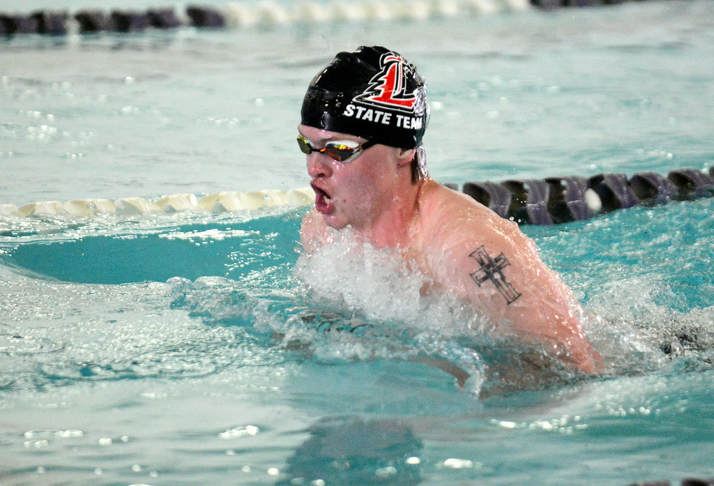 . Loveland\'s Danny Turner does the breaststroke leg of the 200-yard individual medley at the boys City Meet on Tuesday at the Mountain View Aquatic Center. (Mike Brohard/Loveland Reporter-Herald)