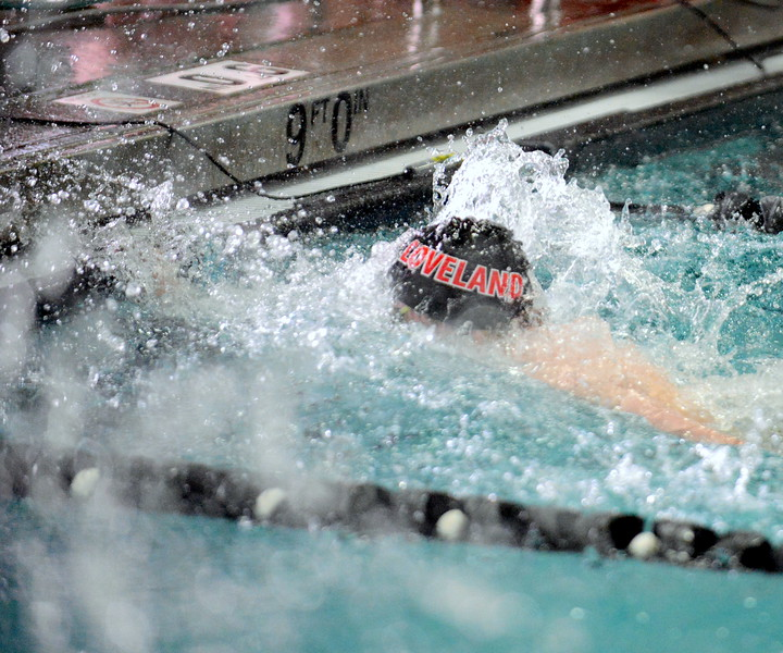Loveland's Jack Curtis touches the wall as the Indians won the 200-yard medley relay at the boys City Meet on Tuesday at the Mountain View Aquatic Center. (Mike Brohard/Loveland Reporter-Herald)