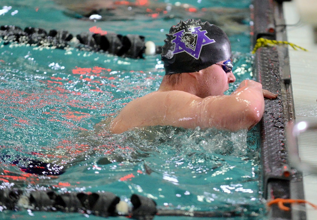 . Mountain View\'s Jonathan Zakanycz looks at the board at the end of the 200-yard freestyle at the boys City Meet on Tuesday at the Mountain View Aquatic Center. (Mike Brohard/Loveland Reporter-Herald)