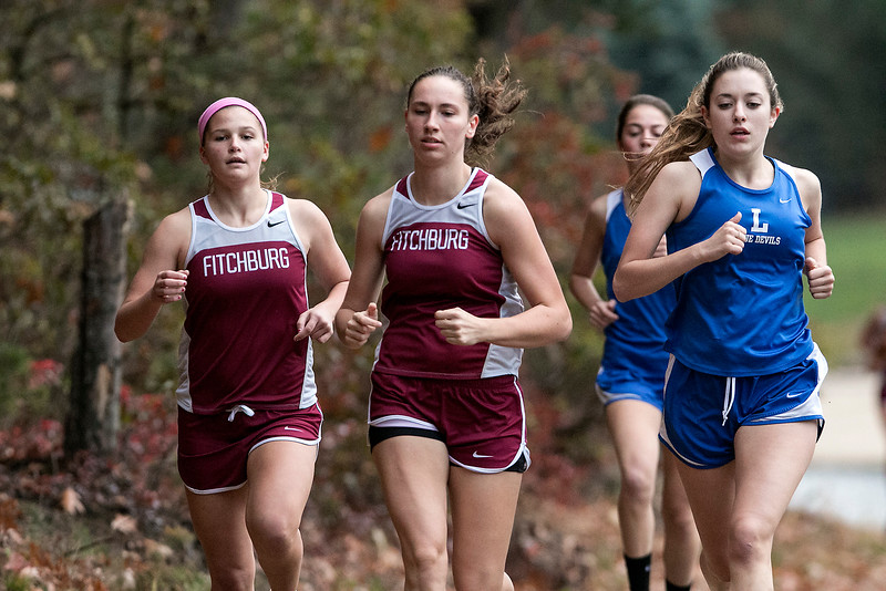From left is Fitchburg High School sophomore Emerson Scott, FHS junior Hannah Neilon and Leominster High school senior Emma Cucchiara competing in the Leominster High School girls cross country meet against Fitchburg on Thursday afternoon at Barrett Park. Scott came in first and Neilon came in second. SENTINEL & ENTERPRISE/JOHN LOVE
