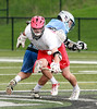 CVU senior captain Steele Dubrul wins a key faceoff in the 4th quarter of the REdhawks dramatic come from behind win.
