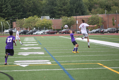 Canton's Brandon Peters with a successful header.