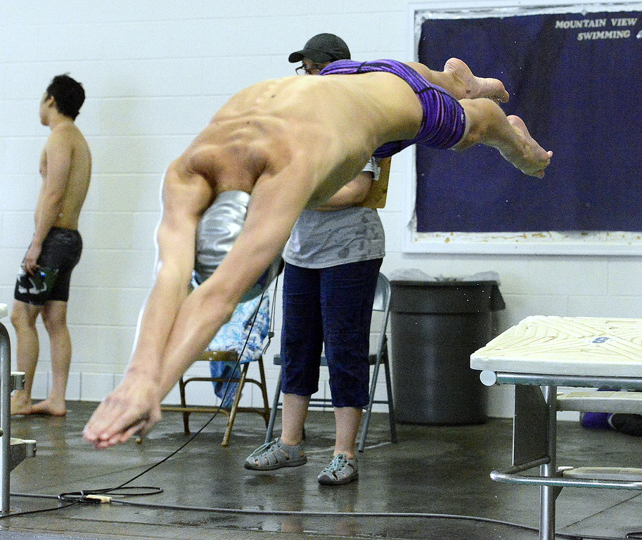 . Mountain View\'s Max Bridges comes off the blocks at the start of the 200-yard freestyle at Saturday\'s Mountain View Invitational. Bridges placed eighth with a time of 2:00.37. (Mike Brohard/Loveland Reporter-Herald)
