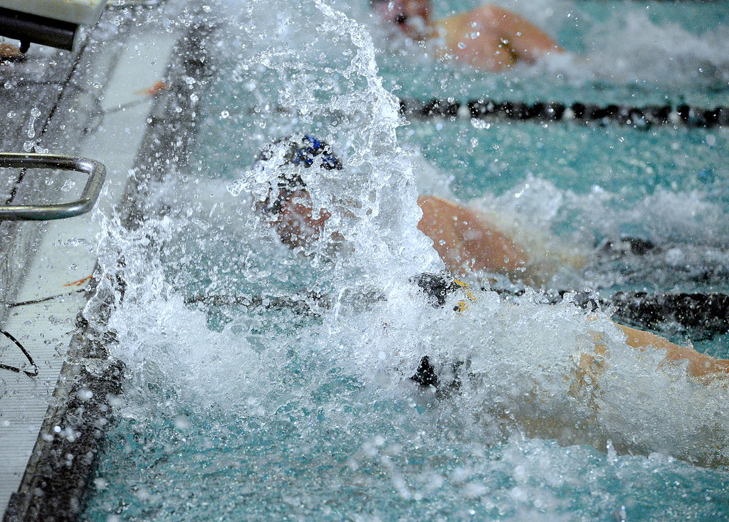 . Thompson Valley\'s Lukas Gately (foreground) closes out the 50-yard freestyle with a splash, finishing third in a time of 22.88 at Saturday\'s Mountain View Invitational. (Mike Brohard/Loveland Reporter-Herald)