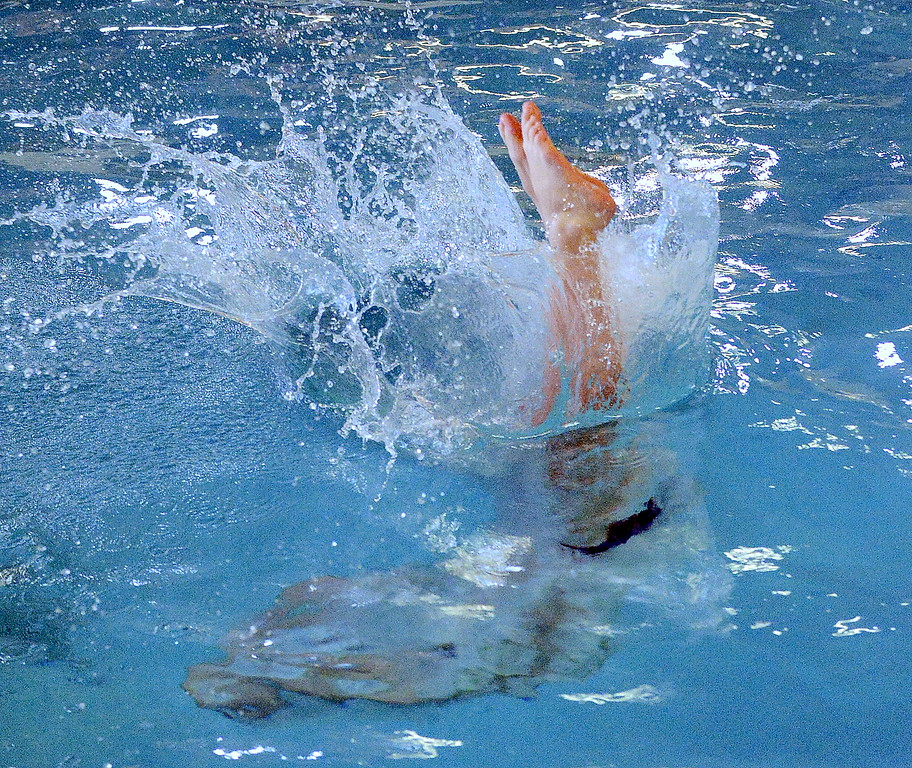 . Mountain View\'s Liam Whitacer finishes a dive at Saturday\'s Mountain View Invitational. He placed eighth with a score of 360.85. (Mike Brohard/Loveland Reporter-Herald)