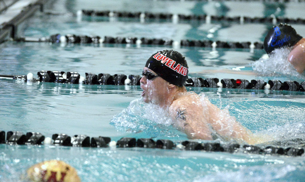 . Loveland\'s Danny Turner comes in for the finish of the 100-yard breaststroke finals at Saturday\'s Mountain View Invitational. Turner was second in a time of 1:01.19. (Mike Brohard/Loveland Reporter-Herald)