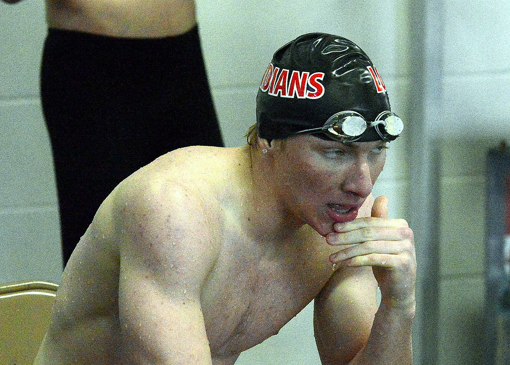 . Loveland\'s Matthew Dennis tries to catch his breath after swimming the 100-yard freestyle at the Mountain View Invitational on Saturday. (Mike Brohard/Loveland Reporter-Herald)