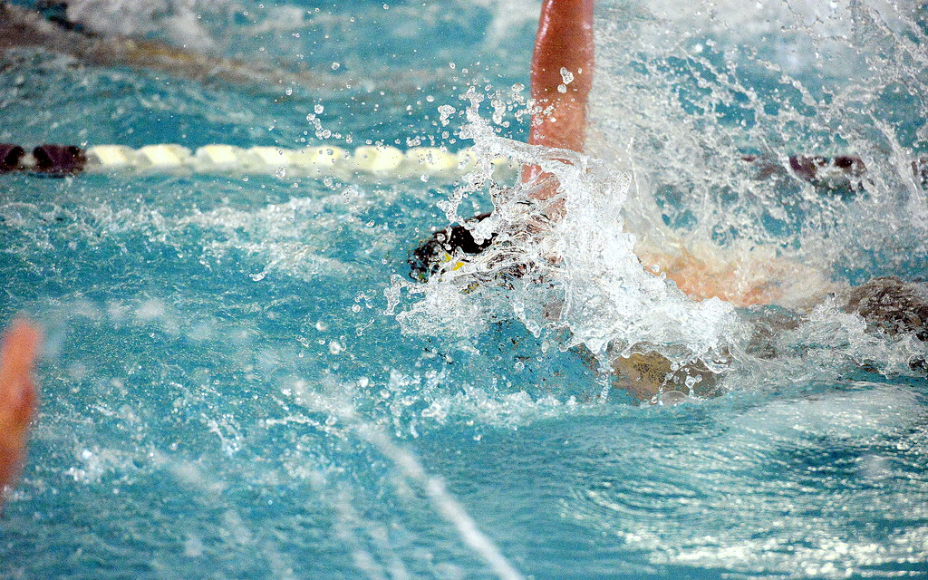 . Thompson Valley\'s Michael Vierra works through the spray of water around him to place 13th in the 100-yard backstroke at Saturday\'s Mountain View Invitational. (Mike Brohard/Loveland Reporter-Herald)