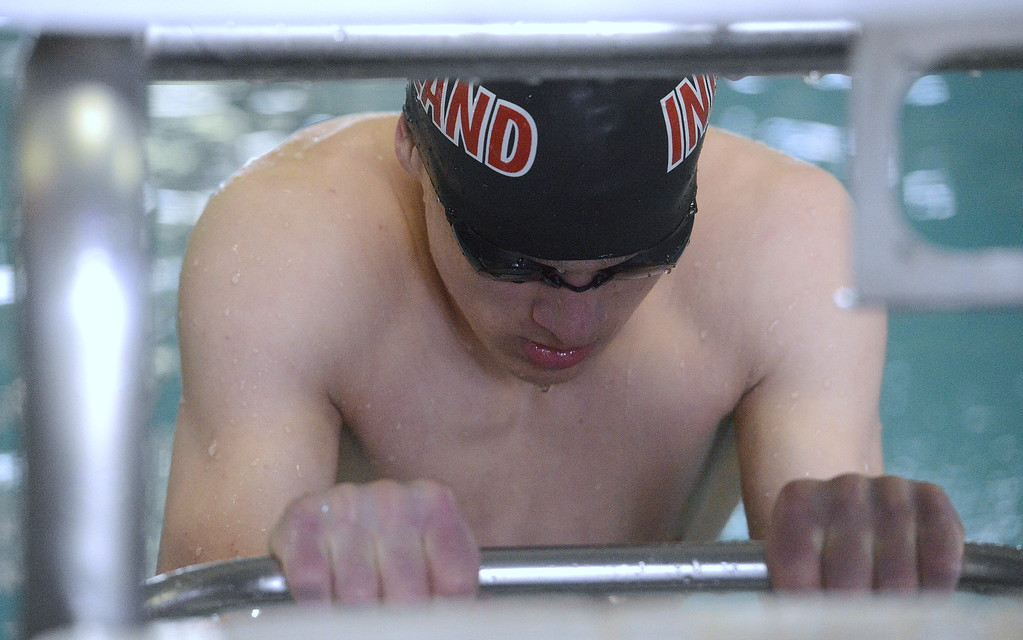 . Loveland\'s Gavin Quinlan collects his thoughts prior to the start of Saturday\'s 100-yard backstroke finals at the Mountain View Invitational. The sophomore took second with a time of 55.72. (Mike Brohard/Loveland Reporter-Herald)
