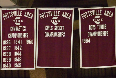 There must have been 25 banners across the gym, each one with at least one championship season noted.  Do you think they could have just left the girls soccer banner down?