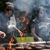 Boys and Girls Club employee Sharon Jordensen (left) and volunteer Katelyn Panajia (right) grill hamburgers for returning runners of Sunday's 5k run/walk at the Leominster Boys & Girls Club in Leominster.  SENTINEL & ENTERPRISE JEFF PORTER