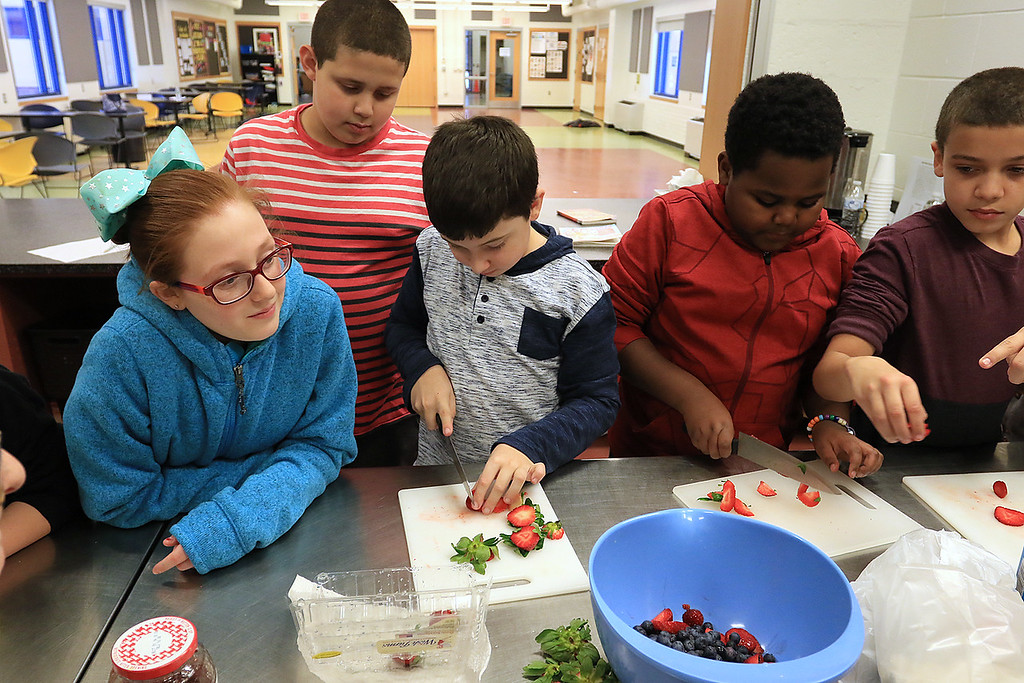. Kids at the Boys and Girls Club of Fitchburg And Leominster participated in a cooking class on Wednesday, February 14, 2019. They learned to make pancakes and a topping of strawberries and blueberries. They heated them up to make a sort of jam for a topping. They where trying to be healthier then butter and syrup. Kids cut up the strawberries in the class. SENTINEL & ENTERPRISE/JOHN LOVE