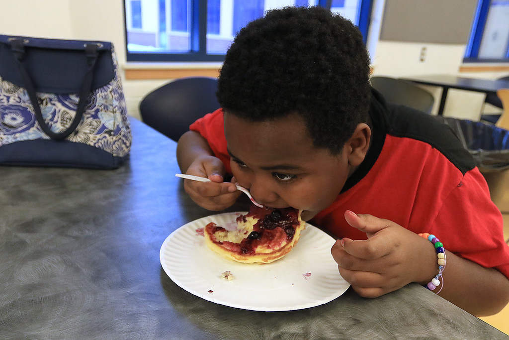 . Kids at the Boys and Girls Club of Fitchburg And Leominster participated in a cooking class on Wednesday, February 14, 2019. They learned to make pancakes and a topping of strawberries and blueberries. They heated them up to make a sort of jam for a topping. They where trying to be healthier then butter and syrup. Jayvon Moore, 9, enjoys one of the pancakes he helped to make. SENTINEL & ENTERPRISE/JOHN LOVE
