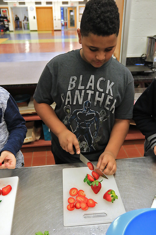 . Kids at the Boys and Girls Club of Fitchburg And Leominster participated in a cooking class on Wednesday, February 14, 2019. They learned to make pancakes and a topping of strawberries and blueberries. They heated them up to make a sort of jam for a topping. They where trying to be healthier then butter and syrup.  Aaron Brown, 10, cuts up the strawberries during the class. SENTINEL & ENTERPRISE/JOHN LOVE