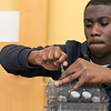 Darin Oti Abankwa, 17, from Leominster was learning how to build an eight cylinder gasoline engine during at a class at the Boys and Girls Club of Fitchburg and Leominster Thursday, Feb. 6, 2020. The class was being taught by Mike Meyer of Westminster. This past January Darin got his license and wanted to learn how to fix his car if something happened, so he could save money, that is why he decide to take the class. The engine they had to build was from a kit. SENTINEL & ENTERPRISE/JOHN LOVE
