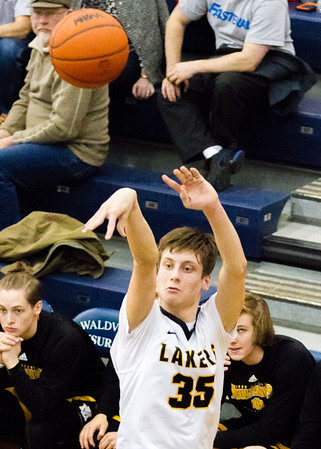Record-Eagle/Brett A. Sommers Glen Lake's Reece Hazelton (35) shoots a 3-pointer during Tuesday's Class C boys basketball quarterfinal against Iron Mountain at Petoskey High School. Glen Lake won 66-49.