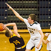 Record-Eagle/Brett A. Sommers Glen Lake's Reece Hazelton (35) attempts to block the shot of Iron Mountain's Marcus Johnson (14) during Tuesday's Class C boys basketball quarterfinal at Petoskey High School. Glen Lake won 66-49.