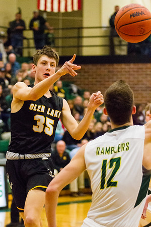 Record-Eagle/Brett A. Sommers Glen Lake's Reece Hazelton passes to a teammate during Monday's Class C regional semifinal game against McBain at Houghton Lake High School. Glen Lake won 66-32.