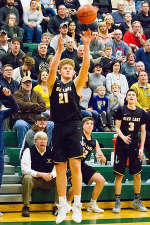 Record-Eagle/Brett A. Sommers Glen Lake's Drew Peterson shoots a 3-pointer during Monday's boys basketball regional semifinal against McBain at Houghton Lake High School. Glen Lake won 66-32.