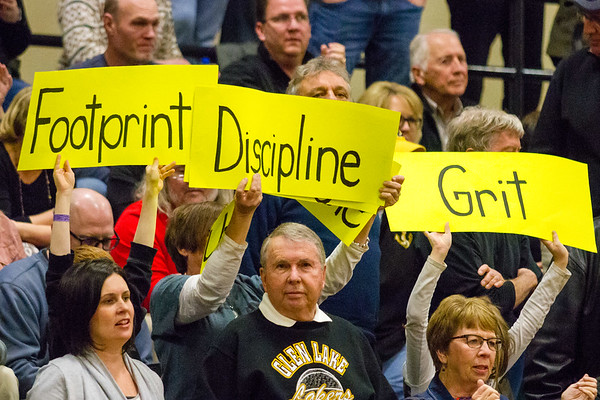 Record-Eagle/Brett A. Sommers Glen Lake fans hold signs during Monday's Class C regional semifinal game against McBain at Houghton Lake High School. Glen Lake won 66-32.