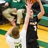 Record-Eagle/Brett A. Sommers Glen Lake's Xander Okerlund shoots a 3-pointer over McBain's Jarrett Koopman during Monday's Class C regional semifinal game at Houghton Lake High School. Glen Lake won 66-32.