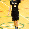 Record-Eagle/Brett A. Sommers Glen Lake's Xander Okerlund runs the point during Monday's Class C regional semifinal game against McBain at Houghton Lake High School. Glen Lake won 66-32.