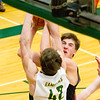 Record-Eagle/Brett A. Sommers Glen Lake's Joey Forsmore attempts to shoot over McBain's George Brown, III during Monday's Class C regional semifinal game at Houghton Lake High School. Glen Lake won 66-32.