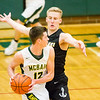 Record-Eagle/Brett A. Sommers Glen Lake's Cade Peterson defends McBain's Garrett VerBerkmoes during Monday's Class C regional semifinal at Houghton Lake High School. Glen Lake won 66-32.