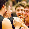Record-Eagle/Brett A. Sommers Glen Lake teammates rush to congraulate J.J. Bradford (middle) after he hit a buzzer beater to end the third quarter during Monday's Class C regional semifinal game against McBain at Houghton Lake High School. Glen Lake won 66-32.