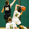 Record-Eagle/Brett A. Sommers Glen Lake's Reece Hazelton attempts to block the shot of McBain's Seager Wiltzer during Monday's Class C regional semifinal game at Houghton Lake High School. Glen Lake won 66-32.