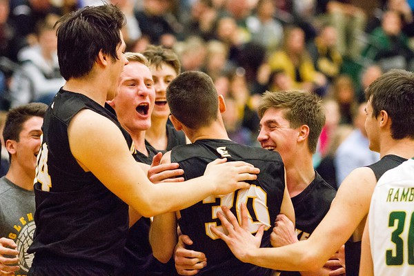 Record-Eagle/Brett A. Sommers Glen Lake teammates rush to congraulate J.J. Bradford (30) after he hit a buzzer beater to end the third quarter during Monday's Class C regional semifinal game against McBain at Houghton Lake High School. Glen Lake won 66-32.