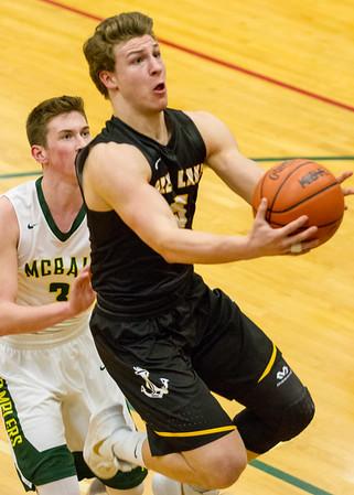 Record-Eagle/Brett A. Sommers Glen Lake's Nick Apsey scores a layup during Monday's boys basketball regional semifinal against McBain at Houghton Lake High School. Glen Lake won 66-32.