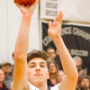 Record-Eagle/Brett A. Sommers Glen Lake's Joey Fosmore shoots during the second half of Friday's district championship game against Traverse City St. Francis. Glen Lake won 61-33.