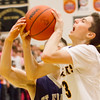 Record-Eagle/Brett A. Sommers Glen Lake's Xander Okerlund goes to the basket during the second half of Friday's district championship game against Traverse City St. Francis. Glen Lake won 61-33.