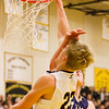 Record-Eagle/Brett A. Sommers Glen Lake's Cade Peterson is fouled by Traverse City St. Francis' Rob Dohm on a dunk attempt during Friday's boys basketball district championship. Glen Lake won 61-33.