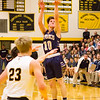 Record-Eagle/Brett A. Sommers Traverse City St. Francis' Danny Passinault launches a 3-pointer during the first half of Friday's district championship game. Glen Lake won 61-33.