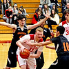 Tyngsboro player #11-Paul Armstrong gets boxed in by Gardner players. SUN/David H. Brow